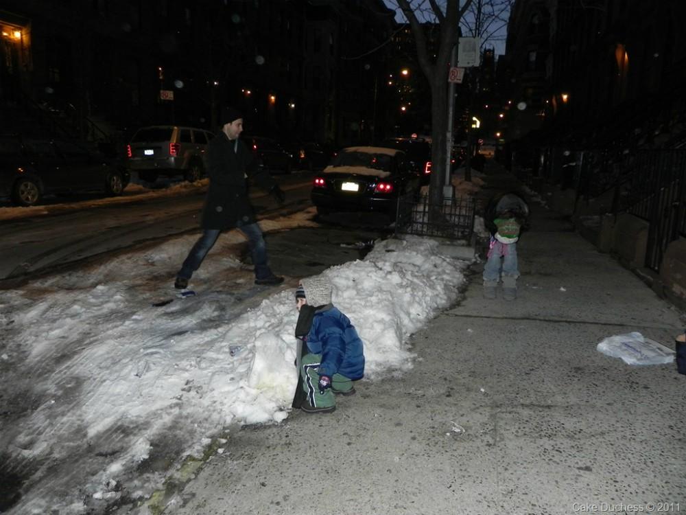 overhead image of snow on a sidewalk