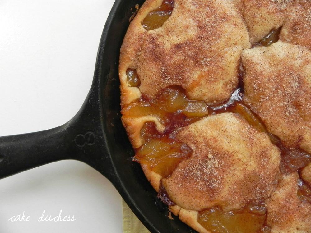 overhead image of cast iron apple cake