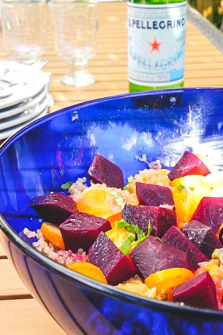 overhead image of beet orange kumquat and quinoa salad