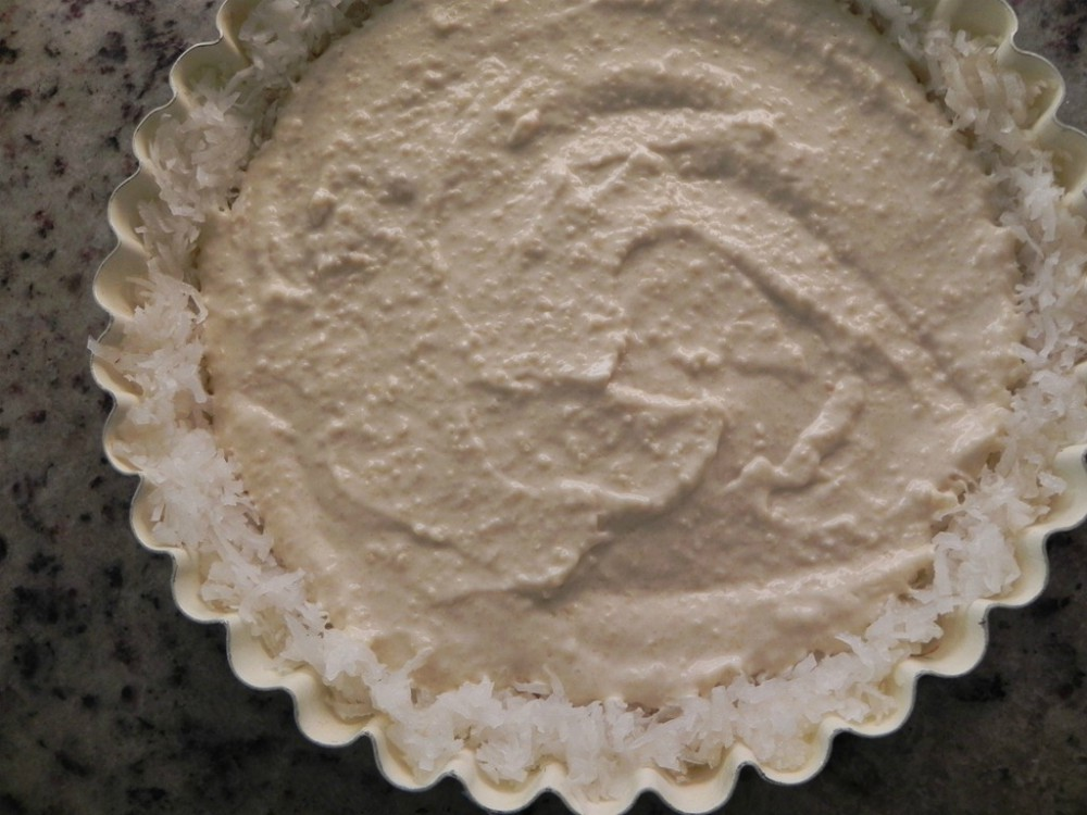 overhead image of coconut tart filling and crust