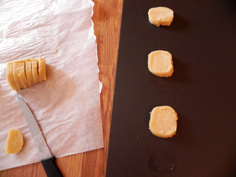 overhead image of sliced cookie dough on baking sheet
