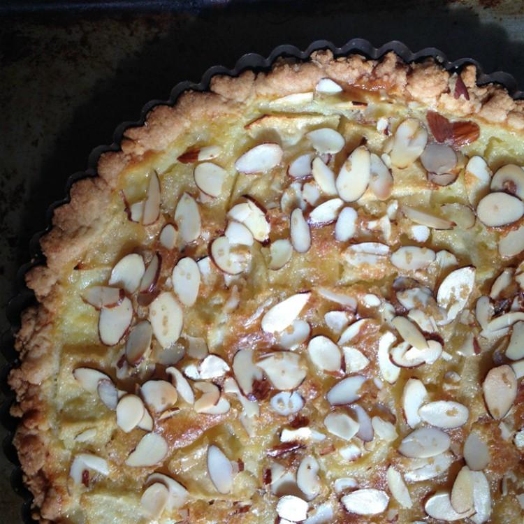overhead image of apple and almond custard tart
