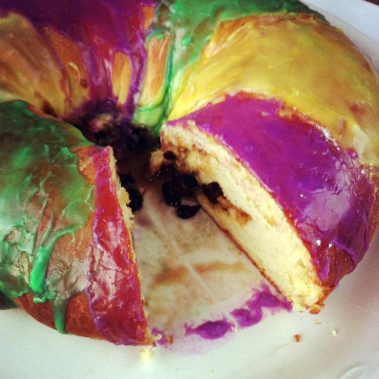overhead image of king cake sliced