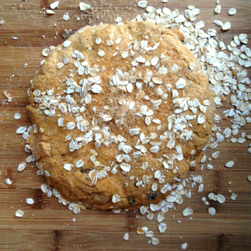 overhead image of dough with oats sprinkled on top