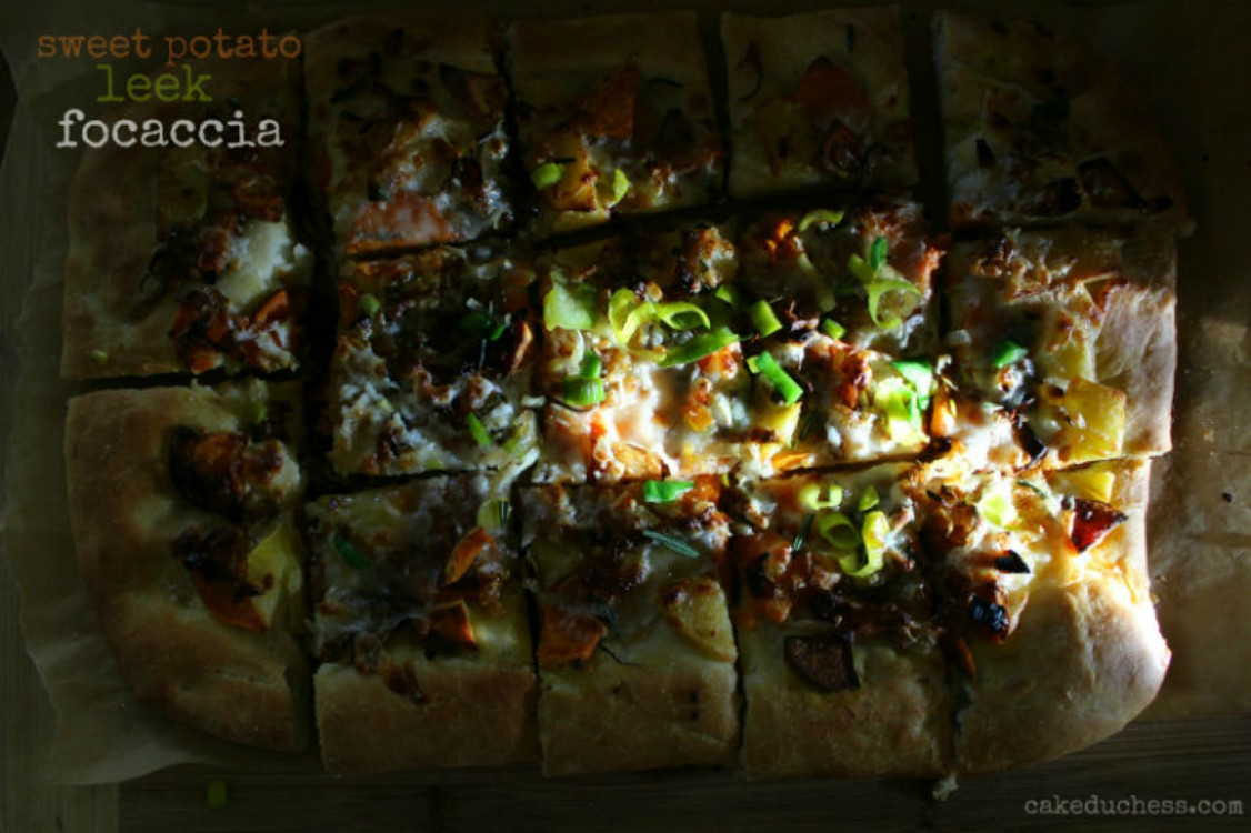 overhead image of bread with vegetable toppings