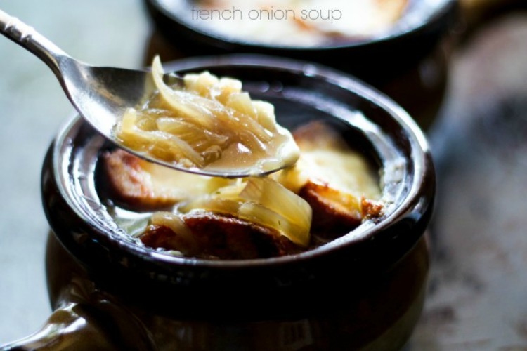overhead image of onion soup in brown bowl