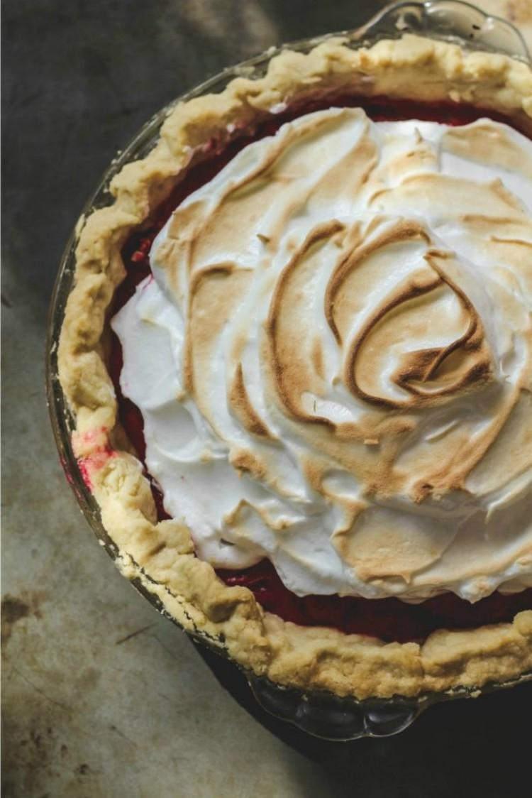 overhead shot of cranberry meringue pie on baking tray