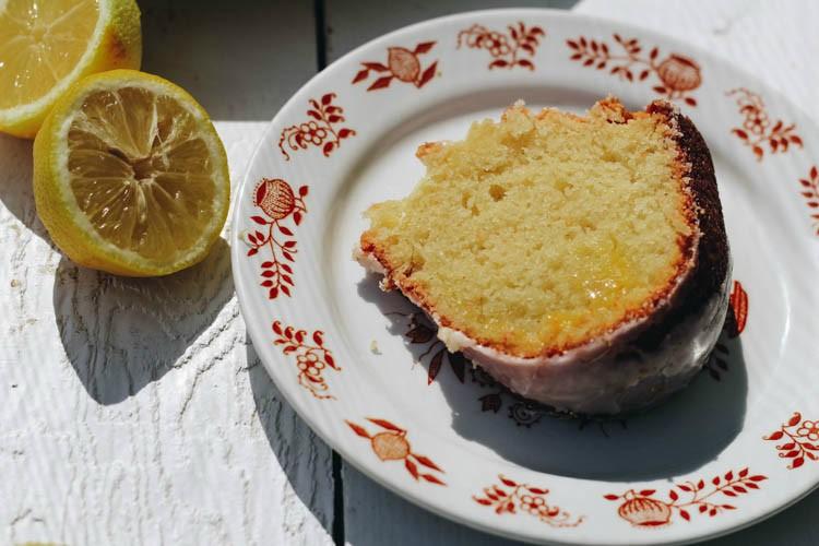 slice of lemon curd cake on white floral plate