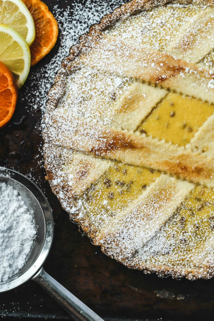 pastiera napoletana dusted with powdered sugar