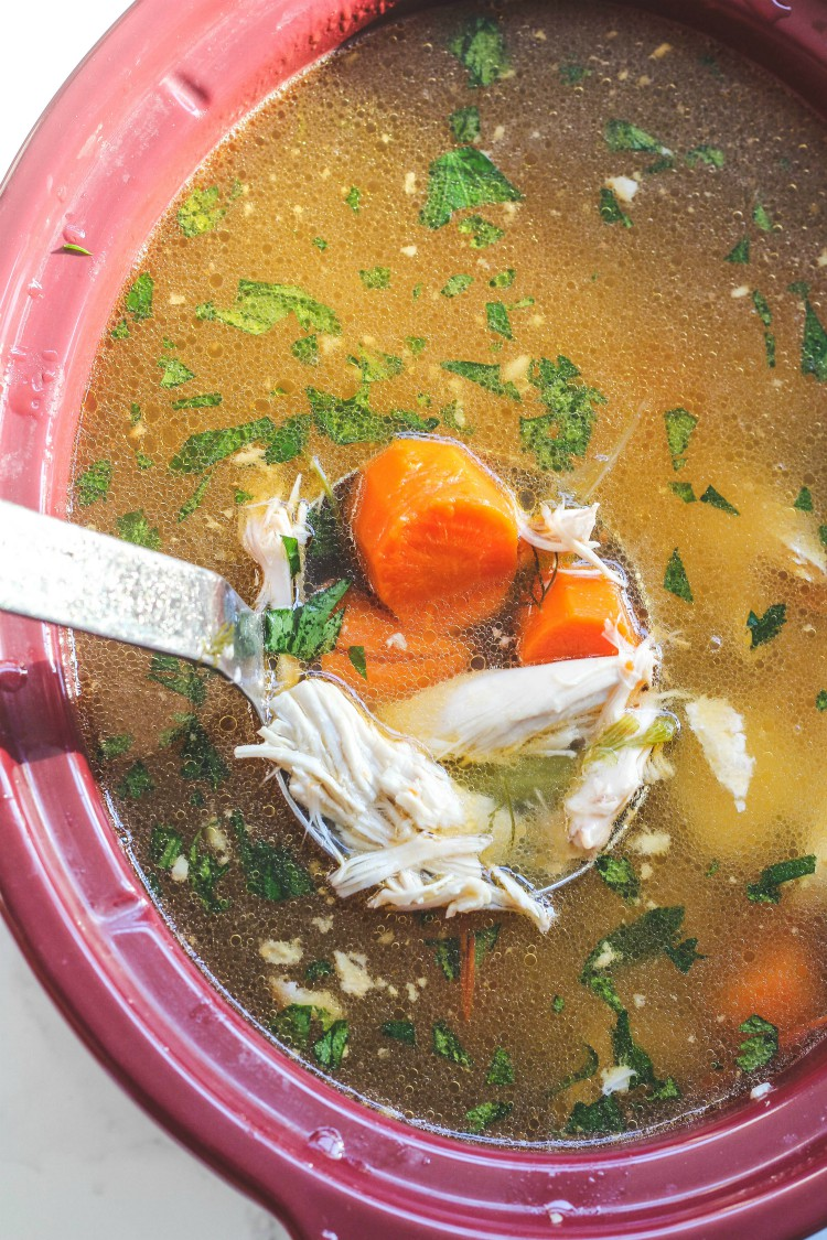 overhead image of chicken soup in slow cooker