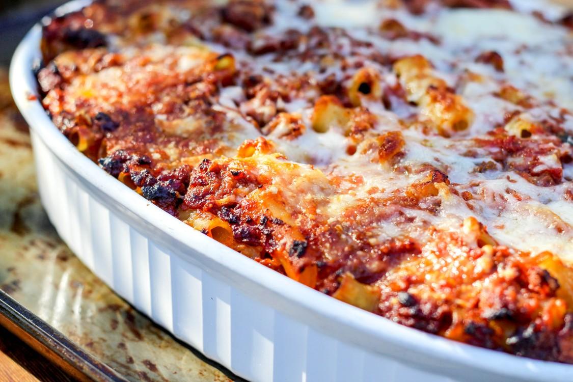 overhead image of ziti al forno in a white casserole