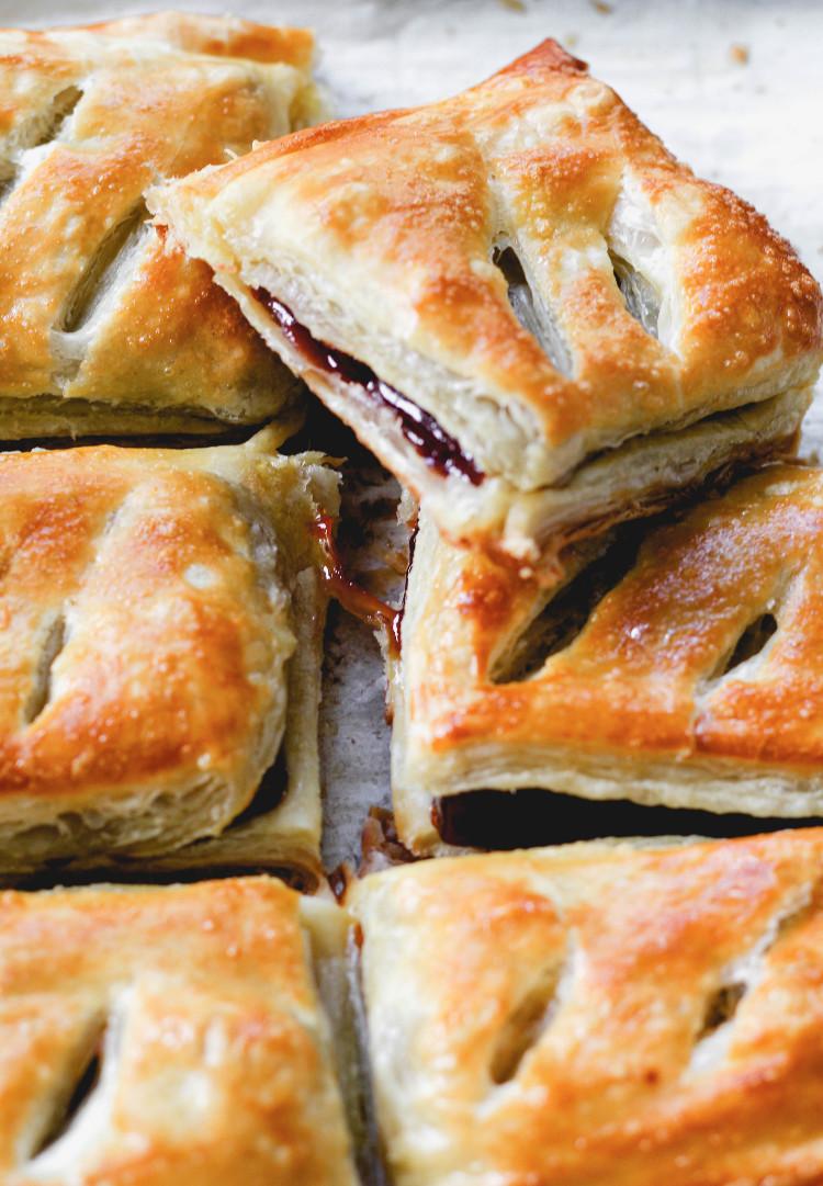 image of pastelitos de guayaba on baking sheet