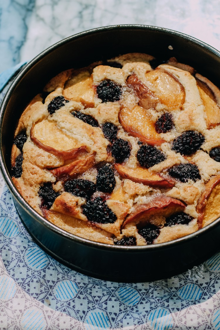 overhead image of gluten-free peach and blackberry cake