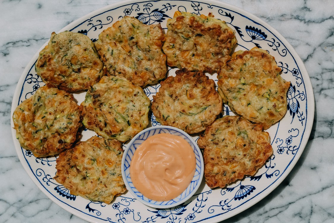 overhead image of fritters on a plate
