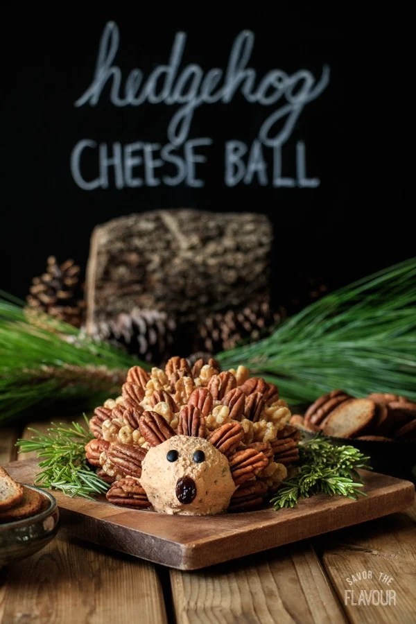 woodland hedgehog cheese ball with rosemary sprigs and pine cones