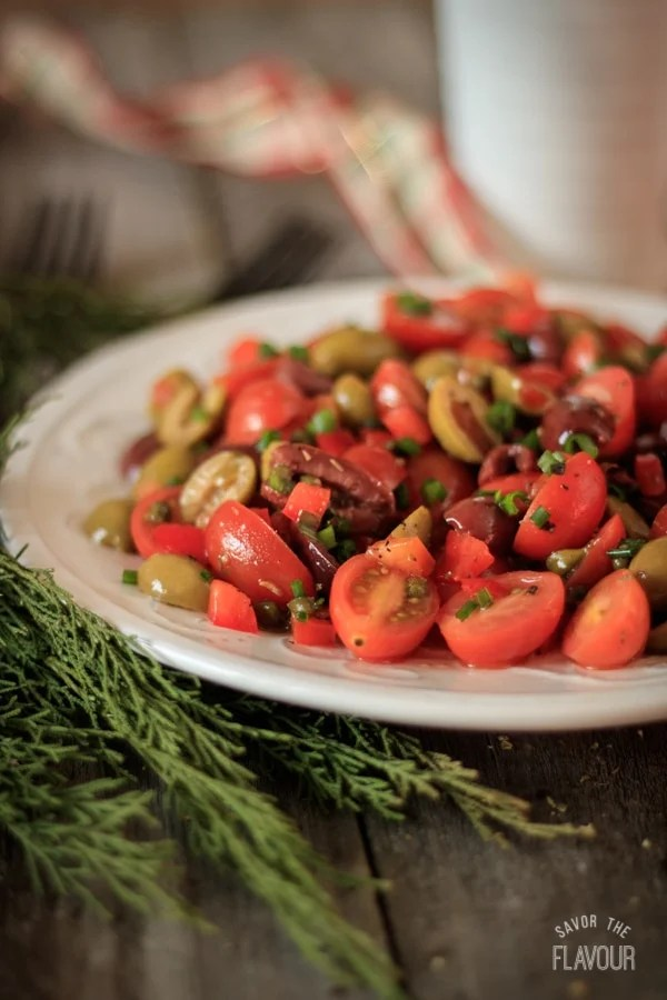 Tomato Olive Salad: olives and capers mixed with tomatoes and a tasty vinaigrette for a super-easy salad. | www.savortheflavour.com