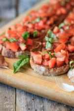 tomato bruschetta on a wooden cutting board