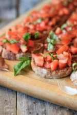 tomato bruschetta on a wooden cutting board