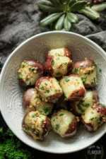 In this easy recipe for Buttery Garlic Parsley Potatoes, new red potatoes are boiled on the stovetop and tossed with brown butter, sautéed garlic, and fresh parsley to make the ultimate gluten free, comfort food side dish. | www.savortheflavour.com #poatotes #glutenfree #sidedish #parsley #comfortfood