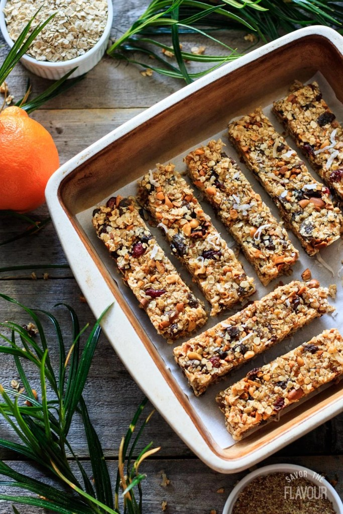 No Bake Citrus Granola Bars: easy, healthy granola bars that are packed with protein to give you energy!  Oatmeal, peanuts, dried fruit, and a hint of orange makes these chewy, gluten free bars a tempting snack.  Feel free to change them up to your tastes! | www.savortheflavour.com #protein #snacks #granola #energybar #glutenfree
