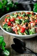 bowl of broccoli salad with two spoons