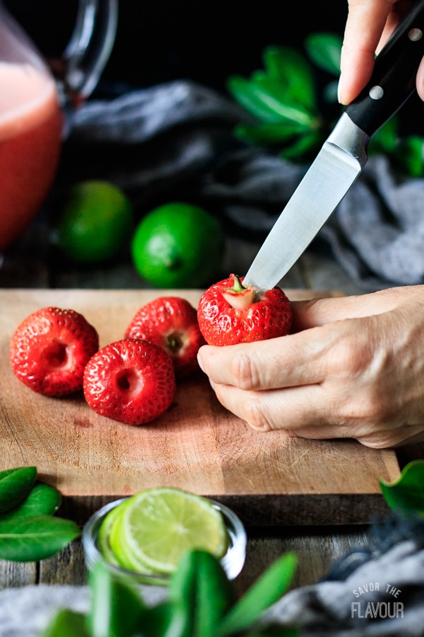 hulling strawberries for non alcoholic strawberry margarita