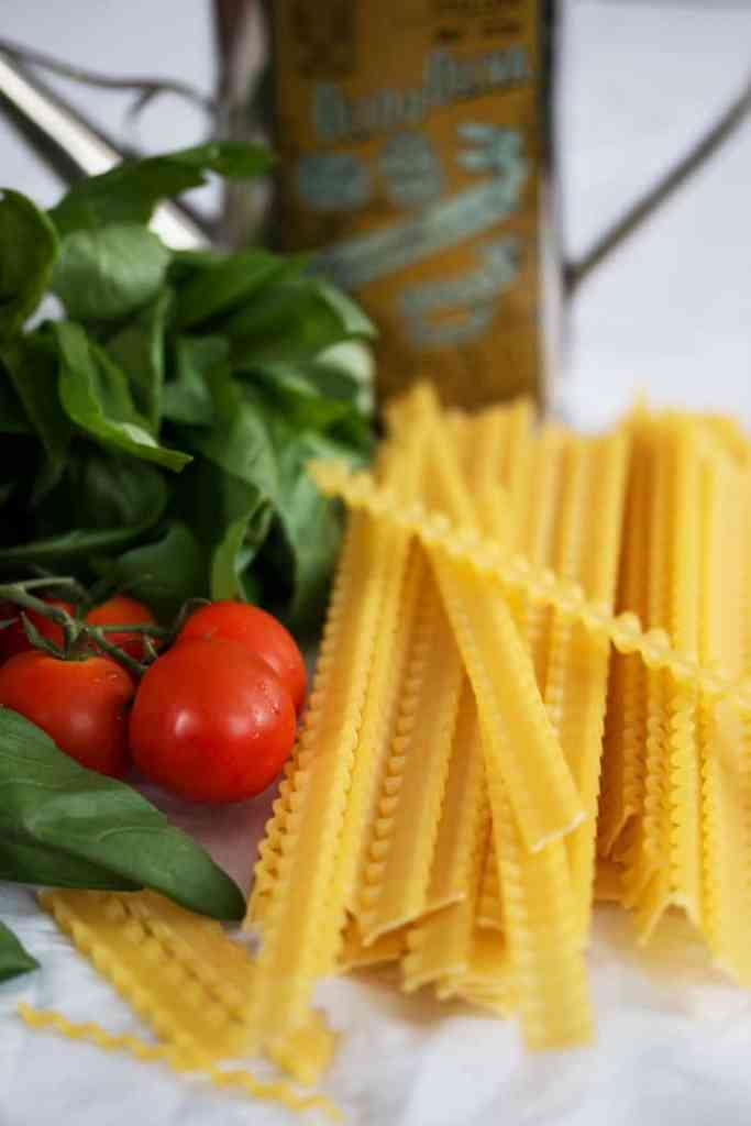 ingredients for mafaldine with tomatoes and cheese