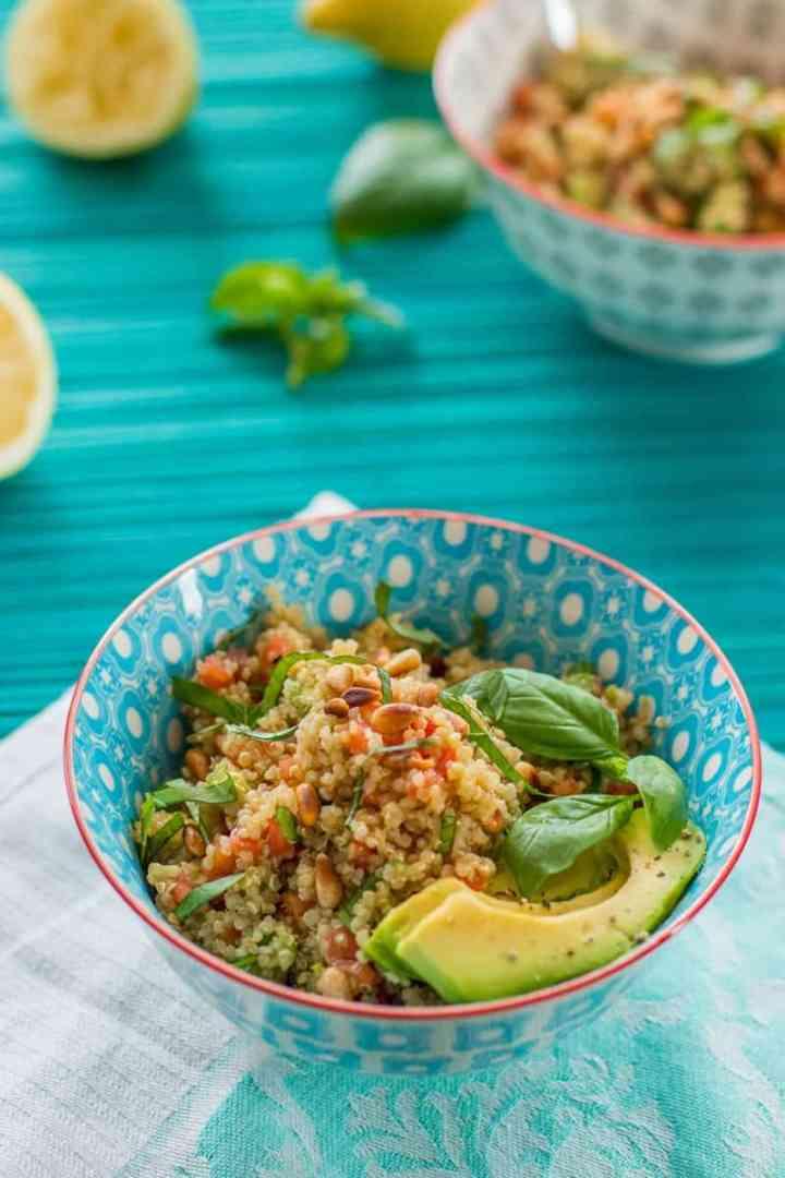 bowl of quinoa salad on a blue tablecloth