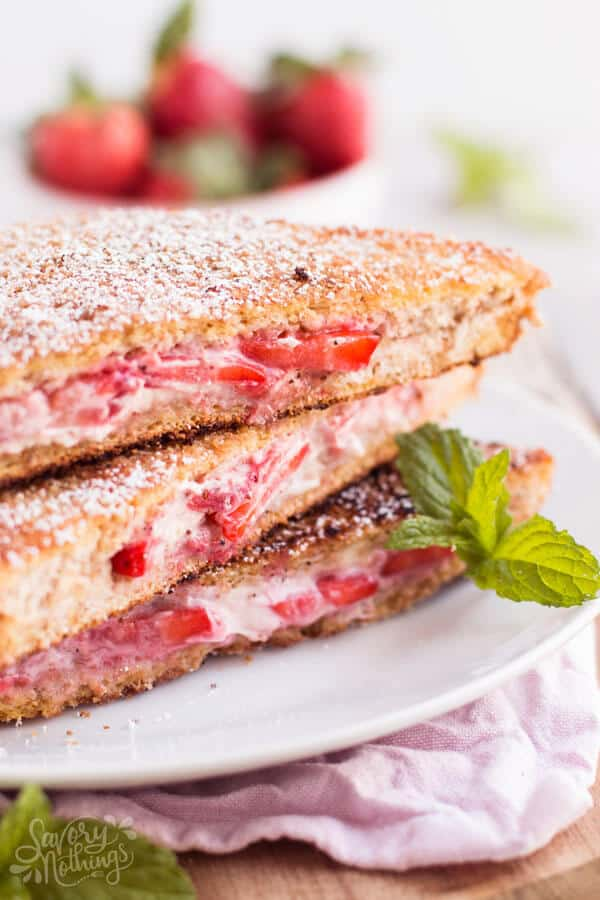 Healthy Whole Grain Cream Cheese Strawberry Stuffed French Toast Recipe via Savoury Nothings is made with whole grain bread, low fat cream cheese, maple syrup and strawberry slices.