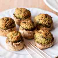 Pesto Stuffed Mushrooms are quick and easy to prepare! Perfect appetizer to serve to a crowd - and delicious and absolutely guilt free too!