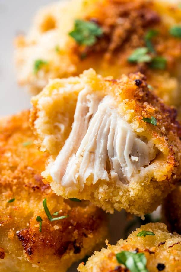 Homemade Healthy Chicken Nuggets are baked in the oven and so much better for you than store-bought! Your kids are going to love these!