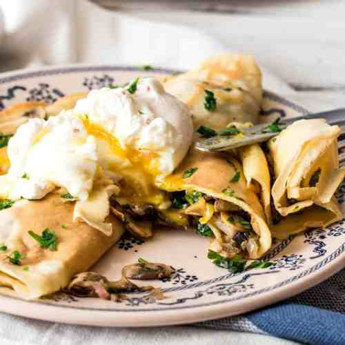 Mushroom Crêpes with Poached Eggs Recipe - A simple yet stunningly elegant dish you can serve up anytime of the day!