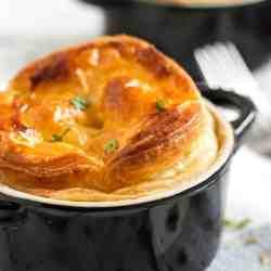 frontal view on chicken and mushroom pot pie in black ramekin