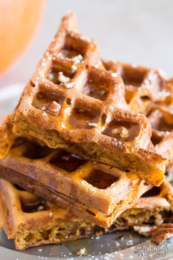 This recipe for homemade simple pumpkin waffles makes a quick batter from scratch with an entire cup of pumpkin, eggs, flour, spices like cinnamon and nutmeg and milk.