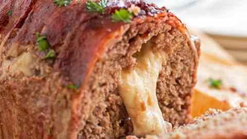 sliced cheese stuffed meatloaf with cheese oozing out