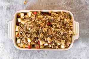 top down view on baking dish with unbaked fruit crisp