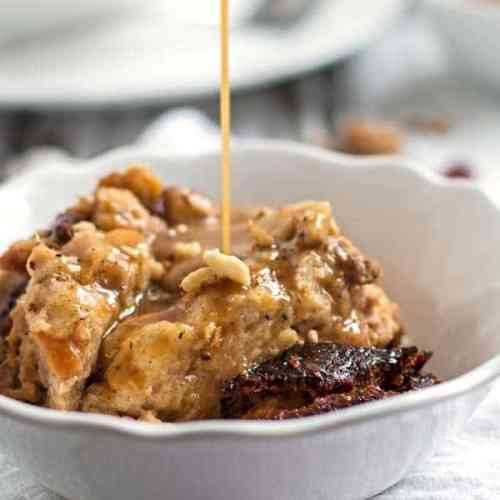 drizzling caramel over slow cooker bread pudding