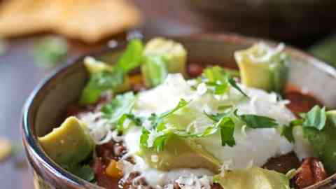 This is the best recipe for homemade Healthy Slow Cooker Chili! It's quick, easy and simple to prepare because it's cooked in a crockpot. This is amazing to serve on gameday or take it with you when you for tailgating!