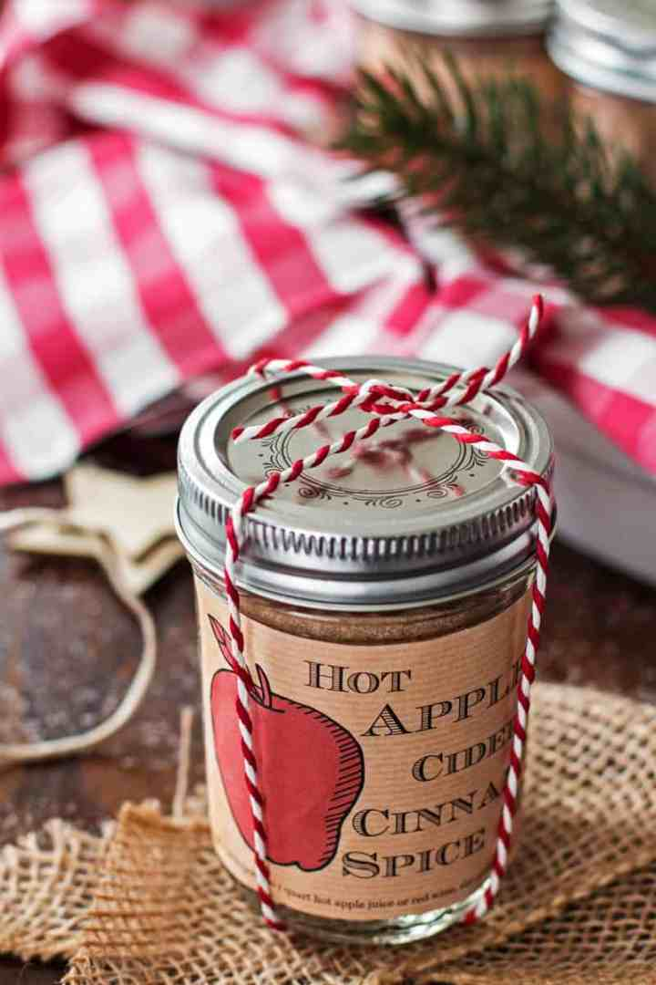jar of apple cider spice mix tied with baker's twine on a festive tables cape