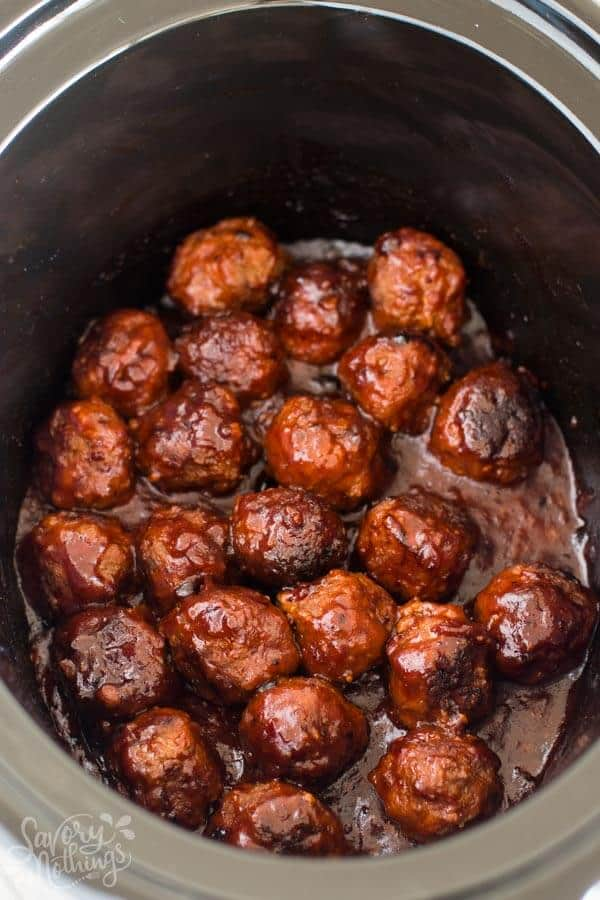 black crock filled with sticky bbq meatballs