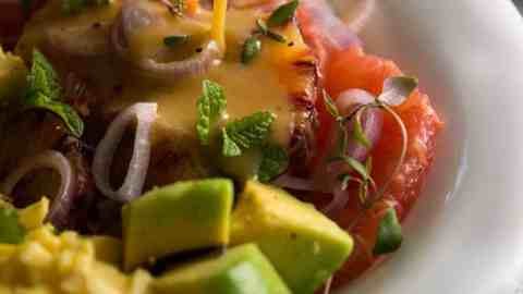 close up photo of dressing drizzling over citrus salad