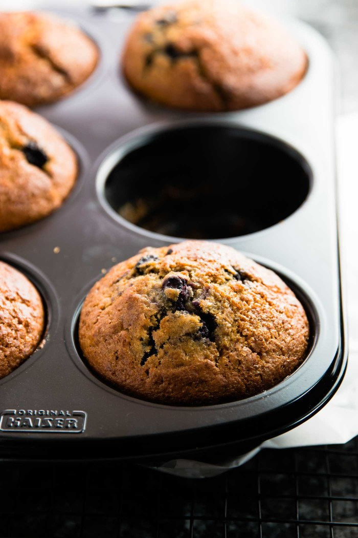 Healthy Blueberry Lemon Muffins - a super easy recipe! Minimal amounts of coconut oil, no white sugar plus all the BEST parts of whole wheat & buttermilk.   savorynothings.com