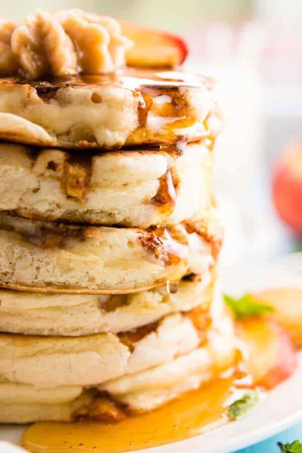 I've never made pancakes as thick and fluffy as these! Made with a mix (so super easy!) and full of cinnamon spiced peaches - yum! Perfect summer breakfast.