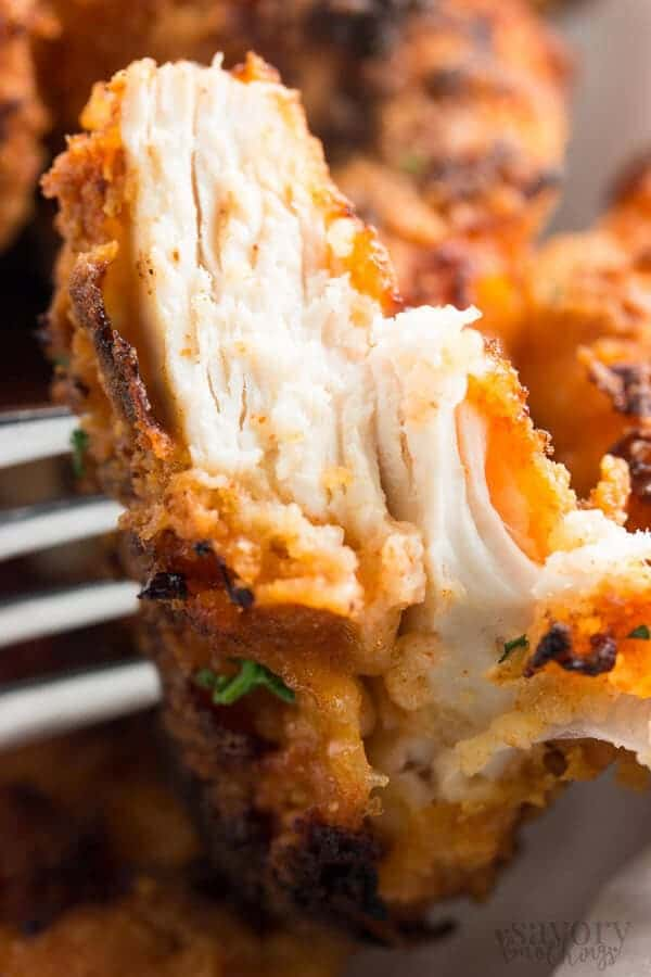 close up photo of a cut open piece of oven fried chicken