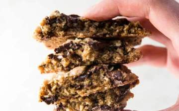 An easy oatmeal chocolate chip cookies recipe full of whole grains for everyday enjoyment. There's less sugar and butter in them, so they're on the healthy side without losing out on those best oatmeal cookie flavors everyone loves!