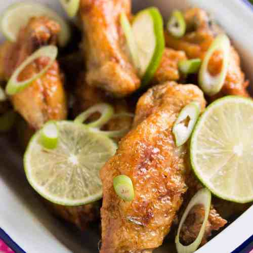 These crispy chicken wings are the perfect game day snack! Pan fried crispy wings with a sticky glaze made from honey, lime juice, zest and spices.
