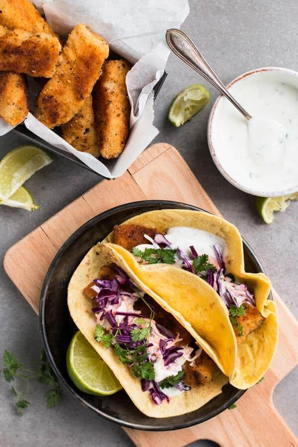Easy Baja Fish Tacos topped with creamy cilantro lime slaw — unbelievably quick and simple to make! Amazing for Cinco de Mayo and all summer long!