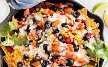Loaded Vegetarian Nachos: your new favorite party appetizer slash dinner slash quick & heat-free summer meal! NO processed cheese sauces to be found here!