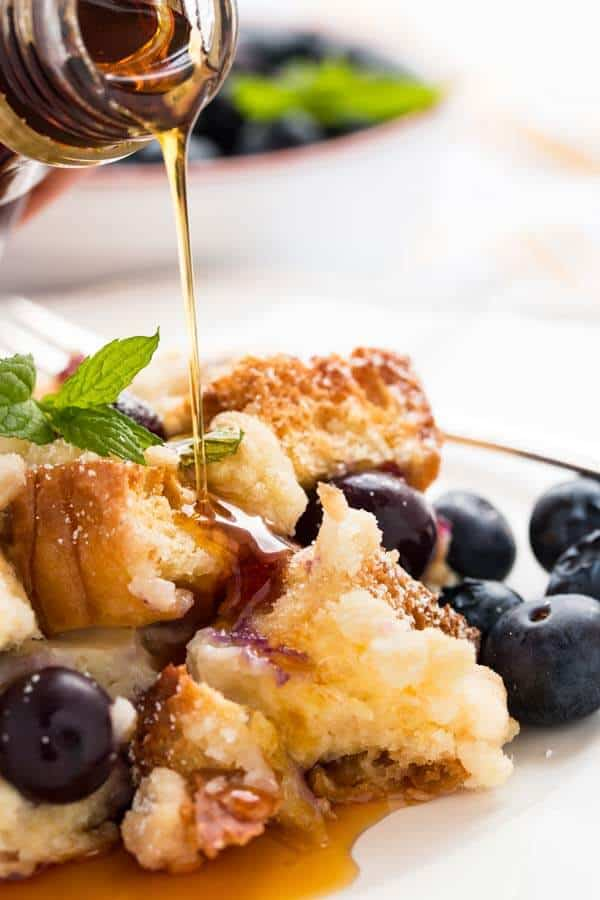 maple syrup drizzling over blueberry French toast