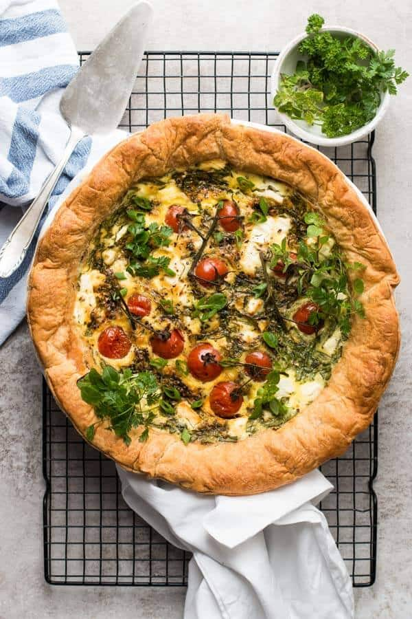 This Easy Tomato Spinach Feta Quiche is packed with flavor and guaranteed to be a hit at your next brunch! Can easily be made a day in advance.